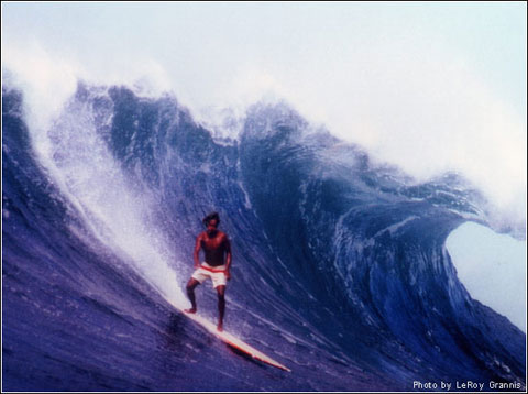 1970's shot of Eddie on a big day at Sunset Beach - Photo by LeRoy Grannis